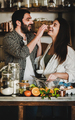 Young caucasian couple playing with flour during baking together - PhotoDune Item for Sale