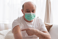 Senior hispanic man wearing face mask showing vaccinated arm. - PhotoDune Item for Sale