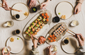 Hands of people enjoying Japanese meal with sushi at home - PhotoDune Item for Sale
