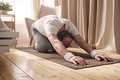 Active senior man doing the child pose while practicing yoga on a mat - PhotoDune Item for Sale