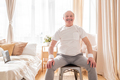 Elderly man wearing sport clothing sitting on chair ready for online yoga lesson - PhotoDune Item for Sale