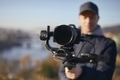 Content creator during filming with camera and gimbal - PhotoDune Item for Sale