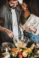 Loving couple mixing ingredients for baking holiday cake together - PhotoDune Item for Sale