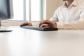Businessman in white shirt typing on a computer keyboard - PhotoDune Item for Sale