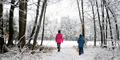 Mother and her son walking in beautiful snowy forest with their cute dog - PhotoDune Item for Sale