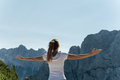 Female hiker enjoying life standing with arms wide open enjoying the view of the Alps - PhotoDune Item for Sale