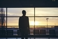 Silhouette of man during waiting at airport - PhotoDune Item for Sale