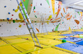 Empty indoor bouldering gym with ladders next to climbing walls - PhotoDune Item for Sale