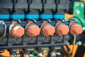 Operating control buttons or knobs in industrial machine. Technology concept - PhotoDune Item for Sale