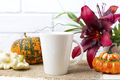 White big coffee latte mug mockup with pumpkin and red lily - PhotoDune Item for Sale