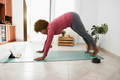 African senior woman doing online yoga class at home - Focus on face - PhotoDune Item for Sale