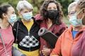 Multi generational women having fun before yoga class wearing safety masks - PhotoDune Item for Sale