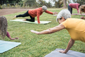People doing yoga class while keeping social distance at city park - Main focus on middle woman face - PhotoDune Item for Sale