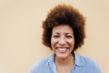 Happy african senior woman smiling on camera outdoors in the city - Focus on face - PhotoDune Item for Sale