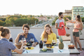 Happy young people eating and drinking wine together at barbecue party - PhotoDune Item for Sale