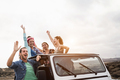 Young people having fun traveling together in convertible 4x4 car during summer vacation - PhotoDune Item for Sale