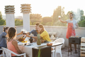 Young friends having barbecue party outdoors at home terrace - Main focus on glasses of wine - PhotoDune Item for Sale
