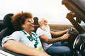 Senior trendy couple inside a convertible car on holiday time - PhotoDune Item for Sale