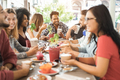 Young multiracial people eating brunch at bar restaurant - Focus on indian man face - PhotoDune Item for Sale