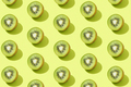 Modern pattern with kiwi slices on a green background - PhotoDune Item for Sale