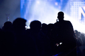 Silhouette of raised hands holding a smart phone recording music concert - PhotoDune Item for Sale