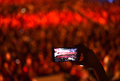 Hand holding smart phone and recording concert at music festival - PhotoDune Item for Sale