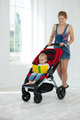 Caucasian young woman pushing stroller with toddler boy indoors - PhotoDune Item for Sale