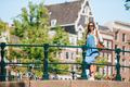 Happy young woman in european city - PhotoDune Item for Sale