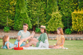 Happy family on a picnic in the park on a sunny day - PhotoDune Item for Sale
