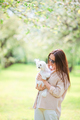 Woman playing and hugging puppy in the park - PhotoDune Item for Sale