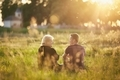 Mother sitting with son on meadow at sunset - PhotoDune Item for Sale