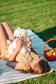 Little smiling girl playing and hugging puppy in the park - PhotoDune Item for Sale