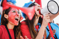 Crazy sport fans playing drums and screaming - PhotoDune Item for Sale