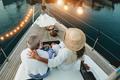 Back view of senior couple having holidays on sail boat - PhotoDune Item for Sale