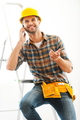 Break for lovely talk. Cheerful young repairman talking on the mobile phone while sitting on ladder - PhotoDune Item for Sale