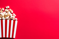 Cinema Popcorn Strtiped Box. Red Border Background. Watching Movies Concept. - PhotoDune Item for Sale
