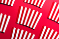 Striped Popcorn Empty Boxes Flat Lay Modern Art. Cinema and Entertainment Background - PhotoDune Item for Sale