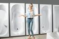 Woman choosing new bathtub in the shop - PhotoDune Item for Sale