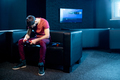 Sad man playing video games with gaming console in the club - PhotoDune Item for Sale
