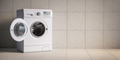 Washing machine on grey wall background. - PhotoDune Item for Sale