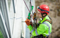 Cheerful industrial climber during winterization works - PhotoDune Item for Sale