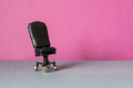 Comfortable black leather office chair on a pink gray background - PhotoDune Item for Sale