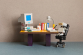 Robot office manager, retro style workplace. Old table with vintage computer, desk lamp and books. - PhotoDune Item for Sale