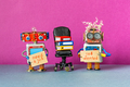 Unemployed robots with a cardboard placards handwritten text Job Wanted and Need a job. - PhotoDune Item for Sale