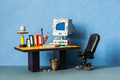 Retro style office workplace. Vintage toy computer, empty blue screen monitor. - PhotoDune Item for Sale
