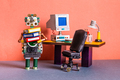 A funny robot office manager holds a bunch of folders with documents - PhotoDune Item for Sale