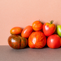 Organic tomato vegetables on pink wall background - PhotoDune Item for Sale
