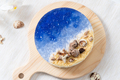 No baked ocean blue cheese cake with chocolate seashells decoration - PhotoDune Item for Sale