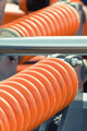 Big and hard orange steel spring as part and detail of industrial or agricultural machine - PhotoDune Item for Sale