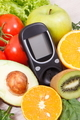 Glucose meter with fresh fruits and vegetables. Healthy nutrition and checking sugar level concept - PhotoDune Item for Sale